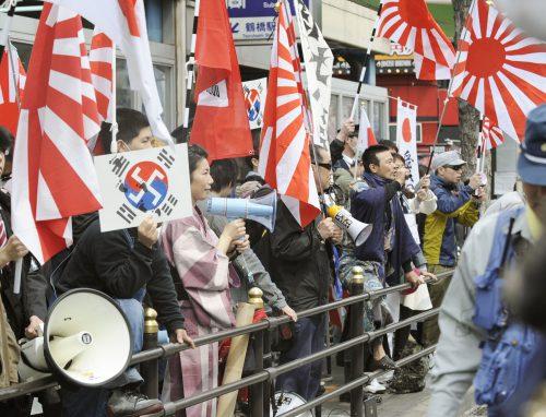 members-of-the-anti-korean-group-zaitokukai-hold-a-rally-in-the-city-of-osaka-in-march-2013-kyodo-jpg